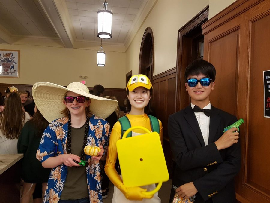 CAULDRON editor Wu '18 with the winners of the Halloween contest