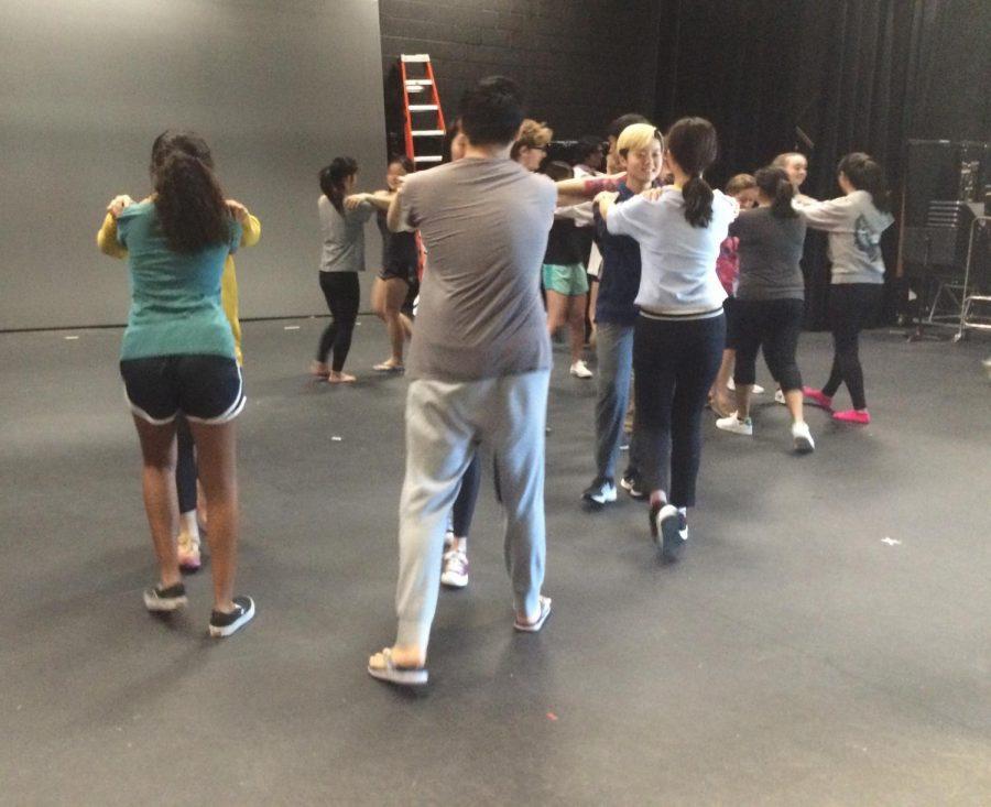 Actors practice stage combat