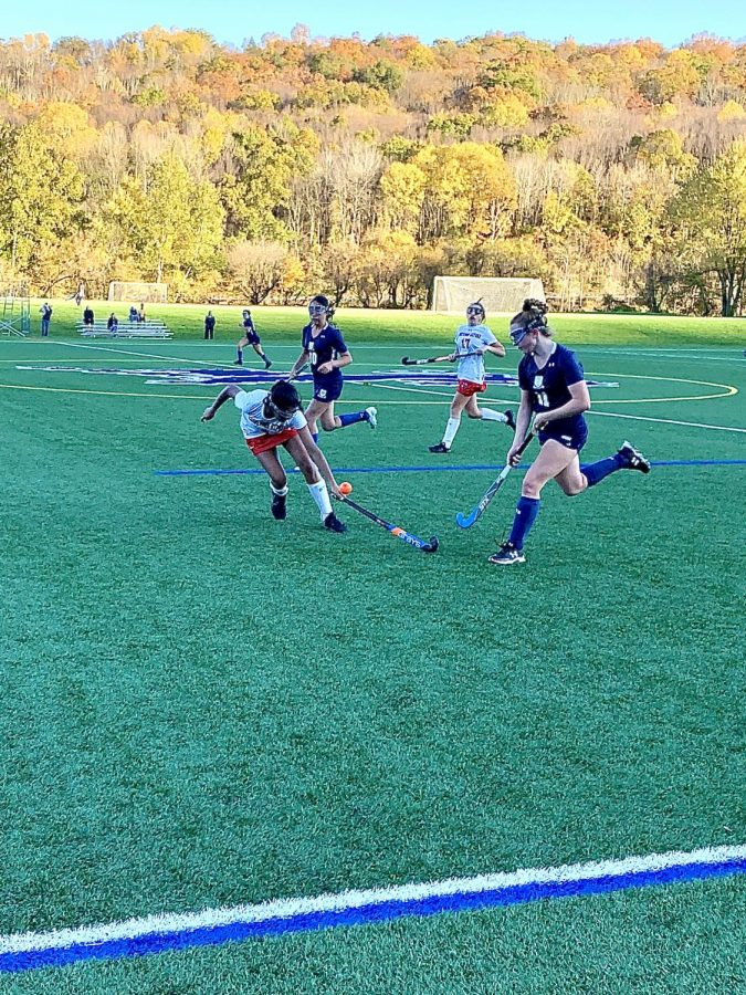 Alexis Delmore '22 slides past Kingswood-Oxford for the goal